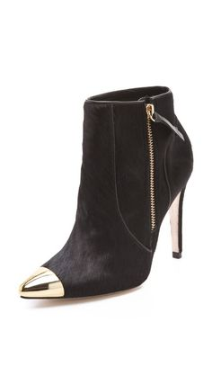 alice + olivia Donnie Haircalf Booties    A pointed metal cap gives this pair of sleek haircalf alice + olivia booties a chic, punk-inspired update. Leather piping accents the seams, and an inside zip fastens the shaft. Covered stiletto heel and leather sole.  413.95 CAD