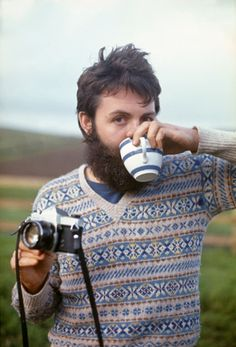 Paul McCartney, multitasker. Coincidentally, he looks like a modern day bearded, fair-isle sweater wearing, tea drinking hipster.