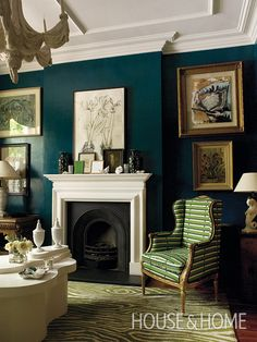 Dramatic peacock-blue walls give designer Colette van den Thillart's own living room a glamorous, jewel-box feel. | Photographer: Chris Tubbs