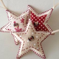 These star-shaped Christmas decorations are handmade to order. Made from wool felt, each of the three ornaments are decorated with a different by SAburns