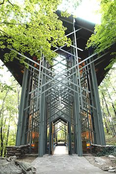 """Thorncrown Chapel. Eureka Springs, Arkansas. 1980 / E. Fay Jones """"This magnificent wooden structure contains 425 windows and over 6,000 square feet of glass. It sits atop over 100 tons of native stone and colored flagstone, making it blend perfectly with its setting."""" The chapel is """"on the U.S. Historic register, has been named one of the AIA's top ten buildings of the 20th century, and has even been called the best American building since 1980."""""""