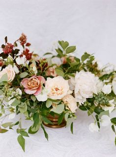We love this floral centerpiece from Sarah Winward (Honey of a Thousand Flowers),