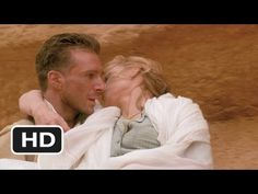 The English Patient Movie Clip - watch all clips http://j.mp/wq6rBo  click to subscribe http://j.mp/sNDUs5    Following the plane crash, Count Laszlo (Ralph Fiennes) carries a wounded Katharine (Kristin Scott Thomas) to the Cave of Swimmers.    TM & © Miramax Films (2012)  Cast: Ralph Fiennes, Kristin Scott Thomas, Colin Firth  Director: Anthony Minghe...