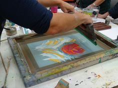 creating a rose monoprint at Annee's workshop, Ochre Print Studio