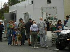 Volunteers from Emergency Medical Services of Northeastern Pennsylvania served plenty of hot dogs to hungry visitors at Heroes Day.