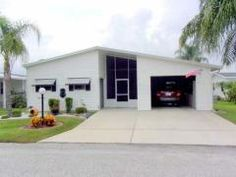 Check out how they did the garage on this home! Cool! 2002 MERIT Mobile / Manufactured Home in Avon Park, FL via MHVillage.com
