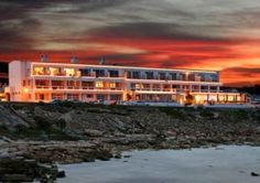 The modern Four Star Arniston Spa Hotel welcomes guests with picturesque views of the unspoilt Indian Ocean and countless beaches. The hotel staff provides exceptional service with friendly and welcoming smiles. The Hotel is 205 km from Cape Town. Clifton Beach, Provinces Of South Africa, Cape Town Hotels, Romantic Road, Hotel Staff, Guest Houses, Fishing Villages, Afrikaans, Great Places