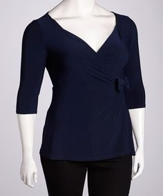 Curve complementing and comfortable, this top with luxurious knit fabric is praise-prompting. A bitty bow lies to the side of the midsection, and a surplice neckline ensures a figure-flattering fit. Measurements (size 0): 27'' long from high point of shoulder to hem92% rayon / 8% spandexMachine wash; hang dry