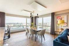 Interior designers Think Contemporary used our Cairo three-arm contemporary chandelier in the dining-space of the luxurious Millenium Tower Penthouse located along Dublin's famous docks   #mullanlighting #madeinireland #chandeliers #chandelierdesign #kitchenchandelier #lightingdesin