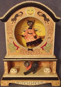 """Another awesome Halloween creation from artist Allen Cunningham. """"Witch Hour""""- black cats in vintage clock case!!"""
