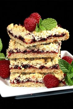 If you're craving oatmeal cookies, try baking these delicious raspberry oatmeal cookie bars! Simply combine raspberry jam, rolled oats, and brown sugar to make this quick and easy dessert recipe. Your friends and family will love this fruit dessert recipe year around! Easy Desserts, Delicious Desserts, Yummy Food, Oatmeal Cookie Bars, Dessert Bars, Fruit Dessert, Chocolate Chip Cookies, Sweet Recipes, Deserts
