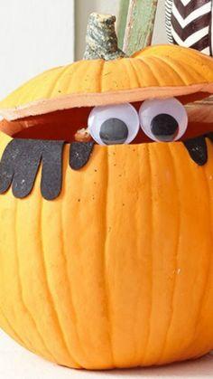 Peek-a-BOO Pumpkin. Instead of googly eyes, it could be a creepy doll. Chucky style