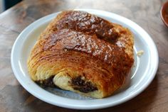 Double pain au chocolat, with a double barrel of dark, almost spicy, melted chocolate.