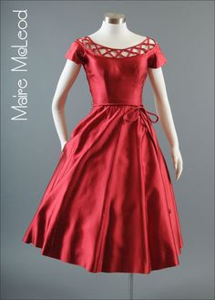 Red duchesse satin party dress with self-fabric corded tie at waist, c. early 1950's.