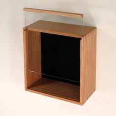 this oak shadow box has a glass front that slides open you have so many