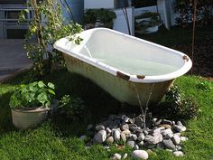 bathtub in the garden!!! use a cast iron tub and heat from below with a wood fire.