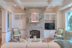 family room. coffered ceiling, posts & trim. built-ins around stone fireplace. gorgeous.