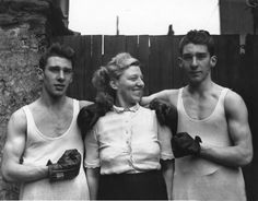 Amateur boxers Reggie (left) and Ronnie Kray with their mother Violet Kray. The Krays went on to become notorious London gangsters. (Photo by Fox Photos/Getty Images)