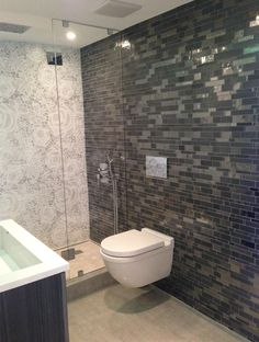 This Modern Bathroom Has Recycled Glass Mosaic Tiles On The Walls Shower Dark Grey Wall Is Called Metropolis Onyx And Light In