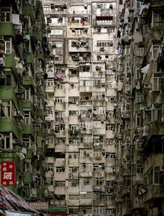 Kowloon Walled city in Hong Kong, 35,000 people living on 100x200 m.