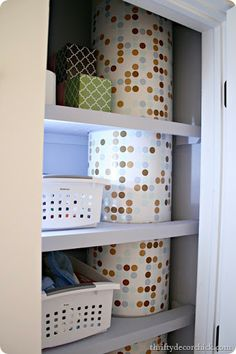 Cover unsightly pipes with contact paper. Via Thrifty Decor Chick- hey Brian this is your pattern! Laundry Chute, Laundry Area, Laundry Shoot, Sticky Vinyl, Dc Fix, Thrifty Decor Chick, Home Management, Red Walls, Break Room
