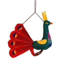 Red Peacock Ornament - Silk Road Bazaar (O) Women in Kyrgyzstan made this stunning peacock ornament by hand from felt. With a loop for hanging and embroidered accents, the ornament's tail measures 8 inches across with a tall bird. Handmade Felt, Handmade Ornaments, Felt Ornaments, Holiday Ornaments, Country Christmas Decorations, Farmhouse Christmas Decor, Felt Decorations, Holiday Decor, Peacock Ornaments