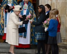 Is that for me? The Queen smiles broadly as she is presented with a bouquet of roses by a ...