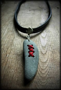 more to come... stone, thread, fine silver wire, old piece of silver from Syria on leather cord.