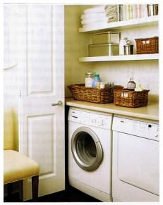 Fantastic hidden laundry room behind folding doors feauturing white front load washer and dryer and custom floating shelves and counter for folding and storage! Laundry Cupboard, Laundry Room Doors, Laundry Closet, Laundry Room Storage, Laundry In Bathroom, Laundry Area, Hidden Laundry Rooms, Small Laundry, Compact Laundry