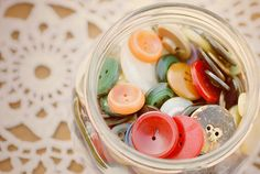 Buttons! I have fond memories of Nanny's button jars...tipping out the buttons onto her worn old kitchen table and playing happily for ages :)