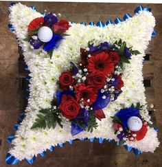 Blue ribbon with a white base and a red and blue spray of flowers - this also includes golf balls as the gentleman was a keen golfer. Yellow Pillows, Summer Flowers, Summer Colors, Pink Flowers, Cushion Arrangement, Funeral Tributes, Flower Spray, Funeral Flowers