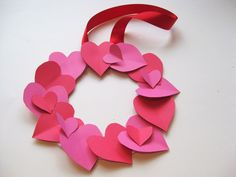 This beautiful and easy heart wreath is the perfect Valentine crafts for kids. All you need is some paper, scissors, and glue—so fun and simple!