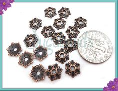50 Antiqued Copper Flower Bead Caps 7mm by sugabeads on Etsy, $3.00
