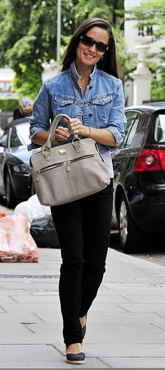 Pippa with blue jean jacket, black pants and big purse.