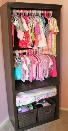 Hiding baby clothes in drawers means they may not all get worn before baby grows out of them.  Turn an old bookcase into perfect storage for baby by hanging rails & using baskets for all those onsies & other small items