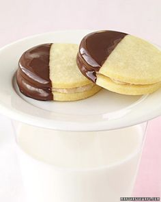 Simple, tender shortbread cookies are made with confectioners' sugar. Fluffy chestnut buttercream is spread between the cookies, and the sandwiches are dipped partway in melted semisweet chocolate. Iced Cookies, No Bake Cookies, Cookie Desserts, Holiday Cookies, Cake Cookies, Cookie Recipes, Dessert Recipes, Shortbread Cookies, Cream Cookies