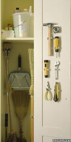 Love how the most frequently used tools are readily available in the broom closet