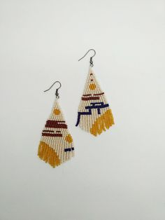 Simple and beautiful hand beaded earrings. Made of high quality czech beads.  Item will be shipped in 1-3 days after the purchace with Registered Priority Mail Worldwide. ----------------- Custom orders are welcome - other colors, forms, patterns etc. Feel free to contact me