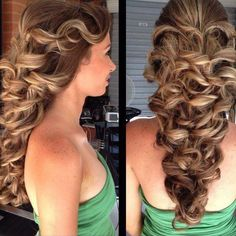Previously curled hair, loosely French braided into 2-4 strands and woven together either by lace braiding or by bobby pinning