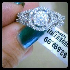 $3,700 Exquisite .80 cttw 10k WG Diamond Ring Offers welcome!  CHECK OUT MY OTHER JEWELRY ITEMS LISTED ALSO! :-)  Over 60 genuine diamonds, tested and guaranteed! New with tag attached, retail priced $3,699.  Set in gleaming 10k white gold, the delicate diamond bands crisscross before embracing the round brilliant center stone with a circle of 24 additional diamonds. This .80 cttw diamond engagement ring is quite eye catching and projects light from every angle. Ring box and gift bag…