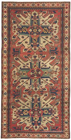 """Caucasian Eagle Kazak (Chelaberd Karabagh), 4ft 2in x 7ft 10in, Dated 1884.     An unusually lyrical and finely rendered """"Eagle Kazak"""" motif, a sensitive, innovative color palette and an inscribed date corresponding to 1885 AD make this prized Chelaberd Karabagh Caucasian rug sublimely captivating. Its elongated dimensions allow for the majestic arrangement of three full """"Sunburst"""" medallions, while an intentionally shortened lower medallion creates a pronounced asymmetry."""