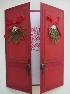 Gate fold door Christmas card with swags of evergreens.