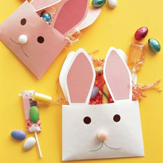 One great way to say happy Easter is with paper-envelope rabbits -- bearing treats, of course.