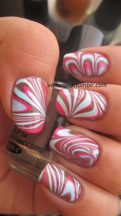 water marbling.. uses too much nail polish and is difficult, but looks SO COOL when it works out right