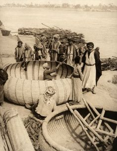 Men build gufa boats on the bank of the Tigris River in Baghdad.
