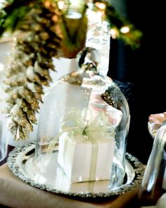 Spotlight a Pretty Package: Place a small gift on a silver tray & cover it with a glass cloche.