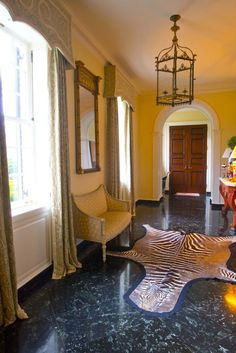 The green marble floor of the entrance hall may appear non-traditional, but its in keeping with the name of the house: Boxwoods.