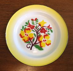 Bright Painted Flower 1940s Enamel Plates - Set of 2 by ShipyardMillies on Etsy https://www.etsy.com/listing/223440297/bright-painted-flower-1940s-enamel