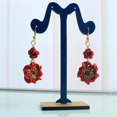 Red Antique Earrings -Handmade earrings from ''Unique handcrafted Jewelry by Arijeta''. These earrings have a flower shape, a small flower on the top and a big one below. There is a metal round piece in the middle of the big flower, which is consisted of antique pieces (crafted flowers with gemstones).  Material: They are made of Metal and Fimo (name for a brand of Polymer Clay).