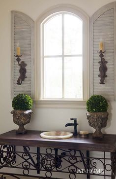 shutters with sconces, so pretty.